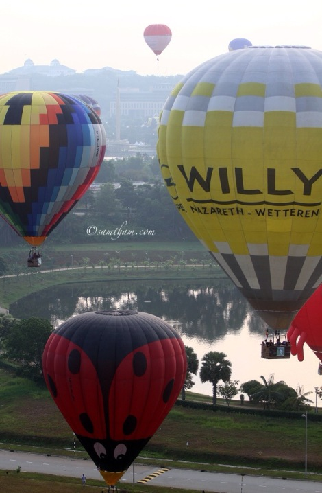 one after another the balloon take off flying over the skyline of Putrajaya